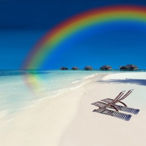 Rainbow over exotic holiday resort